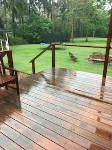 pest control in the rain standing on a wooden deck