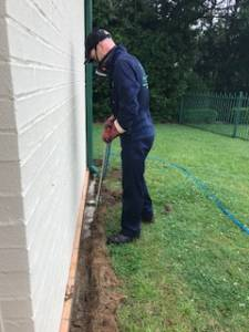 Man doing termite treatments
