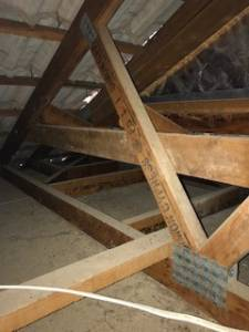 Inspecting roof void in a house
