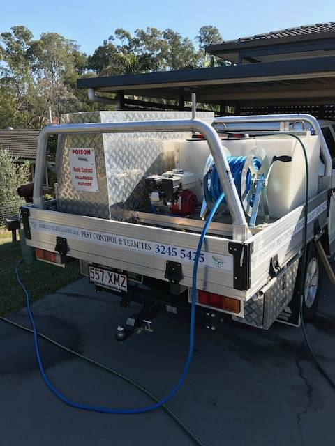 Sunnystate Pest Control's Truck at a pest control Brisbane south side home