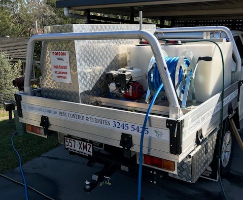 The Sunnystate Pest Control Truck at a home doing a termite barrier treatment