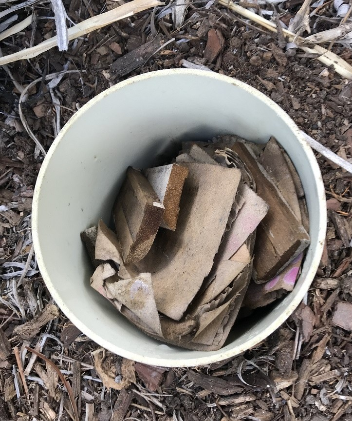 DIY termite bait station filled with wood